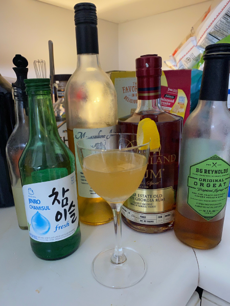cocktail with bottles behind it
